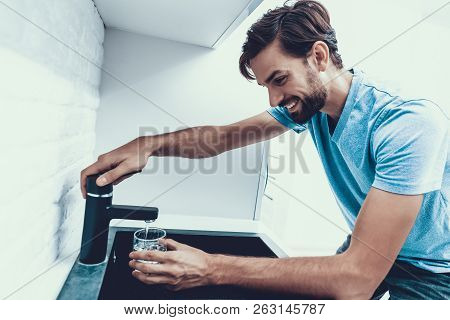 Man In Shirt Drinking Water In Kitchen At Home. Healthcare Concept. Fresh Water. Man In Shirt. Ma In