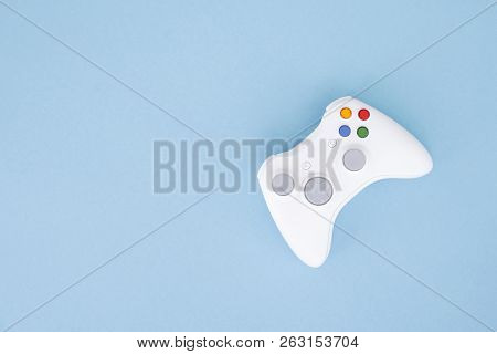 White Joystick Is Isolated On A Pastel Blue Background. Video Game. Gaming Concept. Copyspace. Flayl