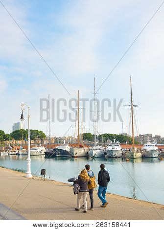 Barcelona, Spain - November 03, 2016: People Walking At A Famous Port Vell Barcelona. Port Vell Is A