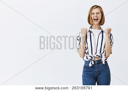 Joyful Optimistic Woman Screaming Out Loud From Happiness, Finally Losing Weight For Summer. Charmin