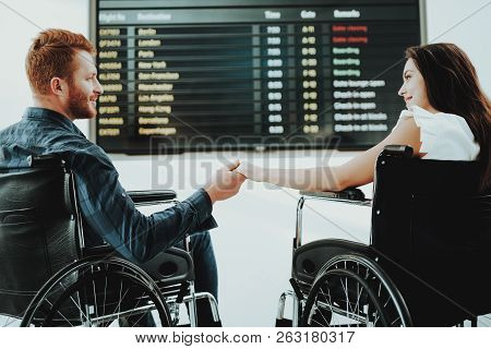 People In Wheelchair. Airport Hall. Woman In Wheelchair. Limited Opportunities. Woman Disabled. Inva
