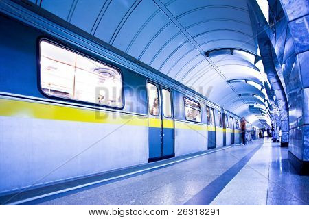 train on platform in subway and people crowd