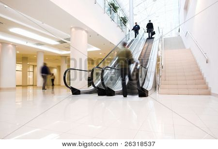 Crowd in office centre on escalator