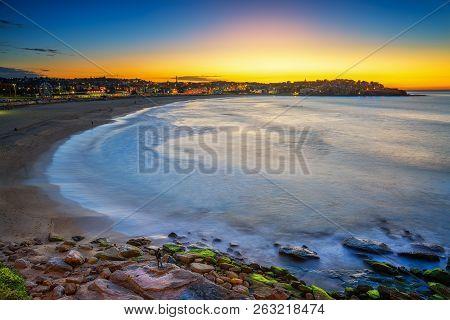 Beautiful morning sunset and Mossy rocks, Port Botany, Sydney, NSW Australia poster