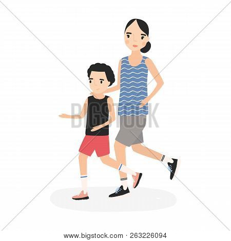 Mother And Son Dressed In Sportswear Running Or Jogging Together. Parent And Child Taking Part In Ma
