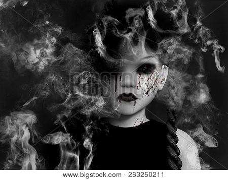3d Rendering Of An Evil Gothic Looking, Blood Covered Small Girl That Is Dissolving In Smoke Like A
