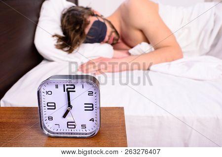 Healthy Sleep Tips. Alarm Clock Before Ringing. Man In Eye Mask Sleep Better. Guy Prefer Relax In Da