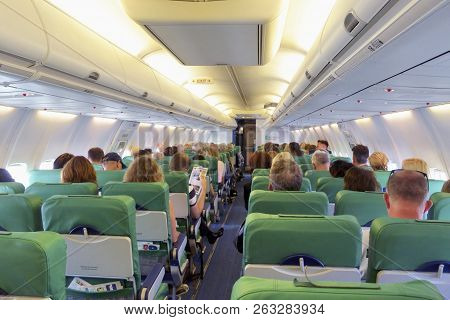 Amsterdam, The Netherlands - September 25, 2018: People Sitting Inside A Transavia Airplane, During