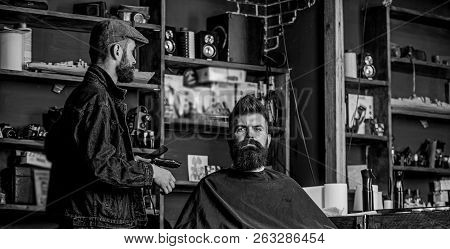 Hipster Client Got New Haircut. Barber With Hair Clipper Looking At Mirror, Barbershop Background. B