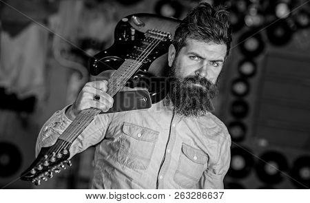 Rock Musician Concept. Musician With Beard Play Electric Guitar. Talented Musician, Soloist, Singer