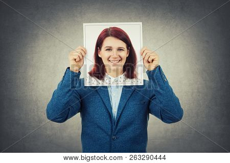Man Covering His Face Using A Woman Portrait, Like A Mask For Hiding His Identity. Business Undercov