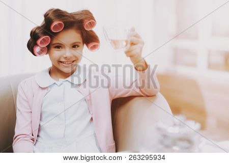 Little Girl With Curlers. Beautiful Little Lady. Girl In Beauty Salon. Little Lady Front Mirror With