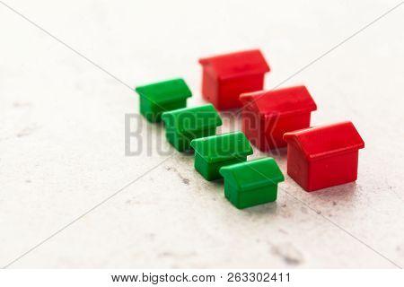 Macro Shot Of Miniature Plastic Houses. Close Up. Object. Macro Photography