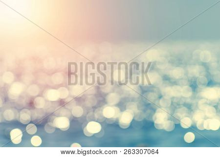 Blur Tropical Beach With Bokeh Sun Light Wave Abstract Background. Copy Space Of Outdoor Summer Vaca