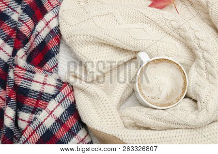 Cappuccino, Milk Knitted Sweater, Checkered Plaid And Autumn Leaves. Fashionable Concept