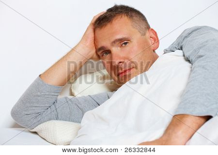 Sleepless night. Man in bed suffering from insomnia.