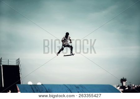 Extreme Sport, Contrast Silhouette Of Young Man, Young Man Doing Jump With Scooter On Background Of