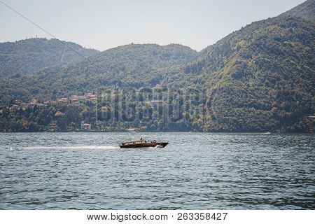 Lake Como, Italy - July 6, 2017: Speed Boat On Lake Como, On A Bright Summer Day.  Lake Como Is The