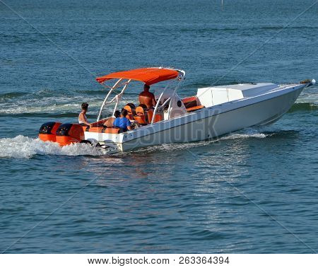 High-end Motor Boat Powered By Two Outboard Engines Cruising The Florida Intra-coastal Waterway Off