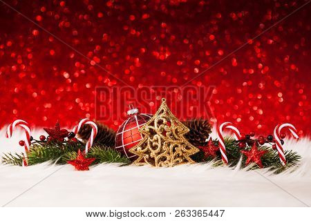 Christmas Background With Decoration On Red Glitter Background