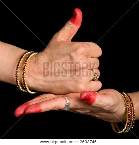 Woman hands showing Shivalinga hasta of indian classic dance Bharata Natyam