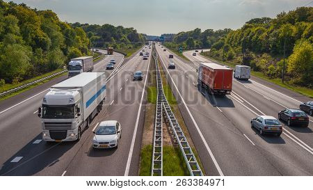 Right Hand Side Evening Motor Traffic On The A12 Motorway. One Of The Bussiest Highways In The Nethe