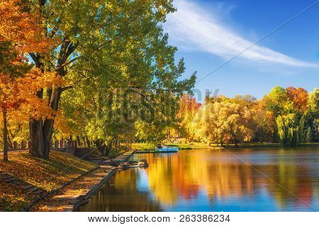 Amazing Autumn Landscape On Clear Sunny Day. Colorful Trees Reflected In Water Surface Of Lake In Pa