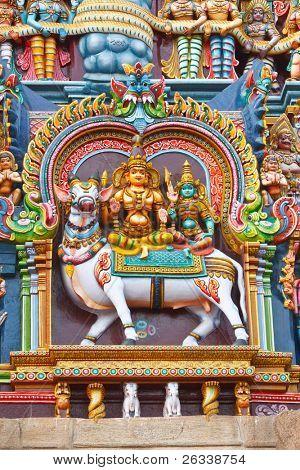 Shiva and Parvati images. Sculptures on Hindu temple gopura (tower). Menakshi Temple, Madurai, Tamil Nadu, India