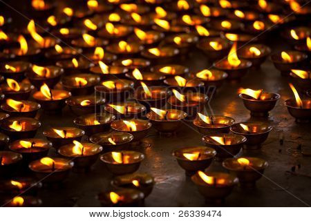 Burning candles in Buddhist temple. Tsuglagkhang complex,  McLeod Ganj, Himachal Pradesh, India. 