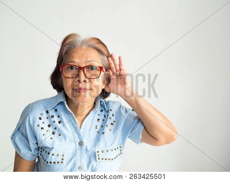 Retire Elderly Old Asia Women Glasses Want To Hear Something Or Can Not Hear Anything In White Backg
