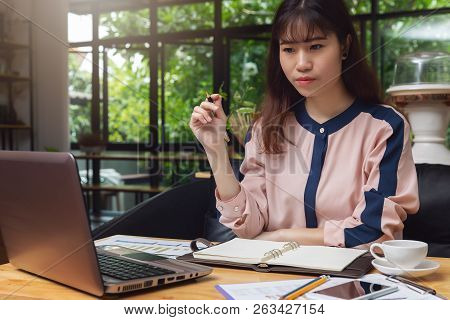 Business And Finance Concept, Businesswoman Holding Coffee Cup And Discussing Sale Analysis Chart In