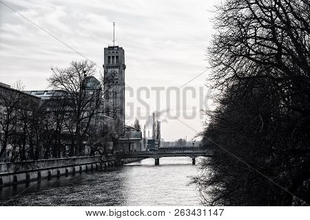 isar river munich with view to well known Deutsches Museum and  bridge in winter. black and white. poster