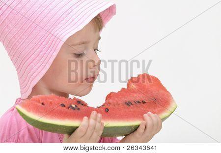 girl eats fresh water-mellon