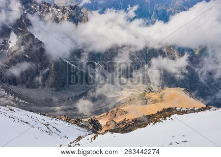 Scenic Alpine Landscape With And Mountain Ranges. Natural Mountain Pastures And Snow-capped Mountain