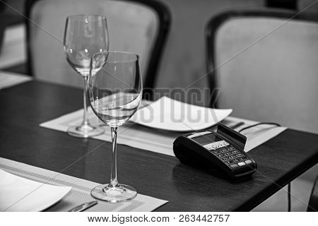 Edc Machine Or Bankcard In Reader On Table In Restaurant