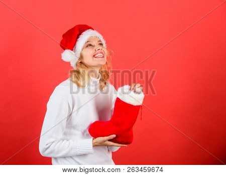 Christmas Stocking Concept. Girl Cheerful Face Got Gift In Christmas Sock. Check Contents Of Christm