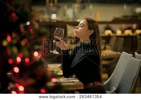 Perfect wine. bar customer sit in cafe drinking alcohol. girl with long hair drink red wine. Pretty woman rest in restaurant with wineglass. Date meeting of woman taster awaiting in pub poster