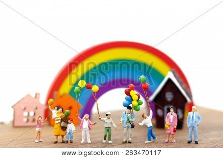 Miniature People: Family And Children Enjoy With Colorful Balloons, House And Rainbow, Happy Family