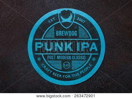 London, Uk - August 22, 2018: Brew Dog Punk Ipa Paper Beer Beermat Coaster On Black Background.