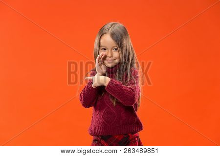 Secret, Gossip Concept. Young Teen Girl Whispering A Secret Behind Her Hand Isolated On Trendy Studi