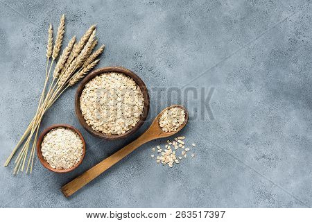 Oats, Rolled Oats And Oat Flakes In Wooden Bowl, Top View. Concept Of Healthy Eating, Healthy Lifest