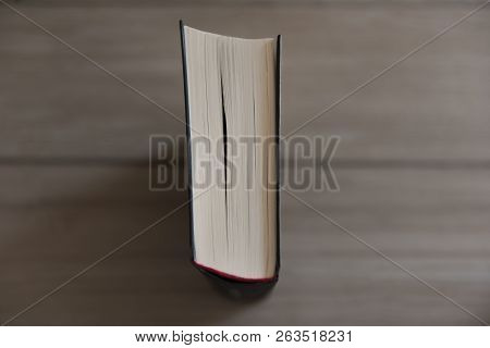 Book Is Standing On A Wood Background