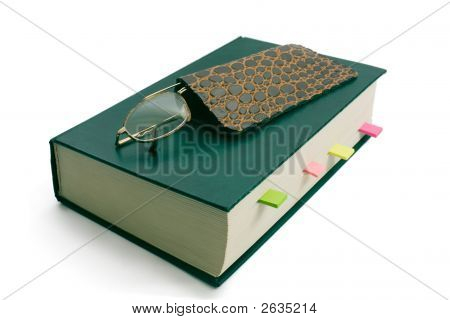 The Reading Glasses On Green Book With Bookmark.