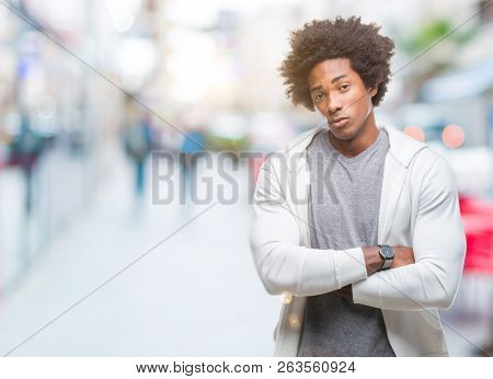 Afro american man wearing sweatshirt over isolated background skeptic and nervous, disapproving expression on face with crossed arms. Negative person. poster