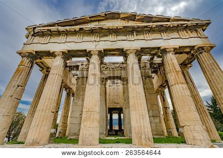 Ancient Temple of Hephaestus Columns Agora Market Place Athens Greece. Agora founded 6th Century BC. Temple for God of craftsmanship, metal working from 449 BC, later church poster
