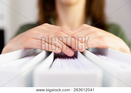 Woman's Hands Holding Accounting Folders. Accounting, Finance, Paper Work Concept.