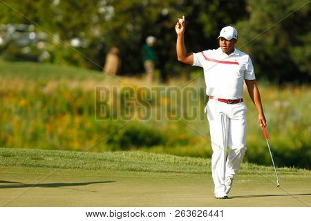 July 1, 2012; Bethesda, MD, USA; Jhonattan Vegas waves to the crowd after putting on the 18th green during the final round of the AT&T National at Congressional Country Club.