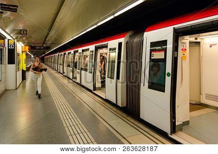 Barcelona, Spain - September 13, 2018: Unknown Girl Goes On Platform Of Sagrada Família Metro Statio