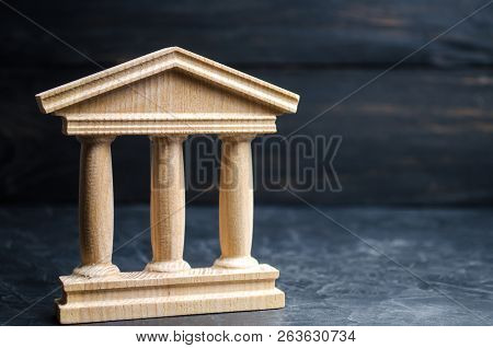 Bank. State Building. Wooden Government Building On A Black Background. Concept Of State Administrat