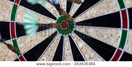 A Darts On The Wall With Dart Hit The Mark